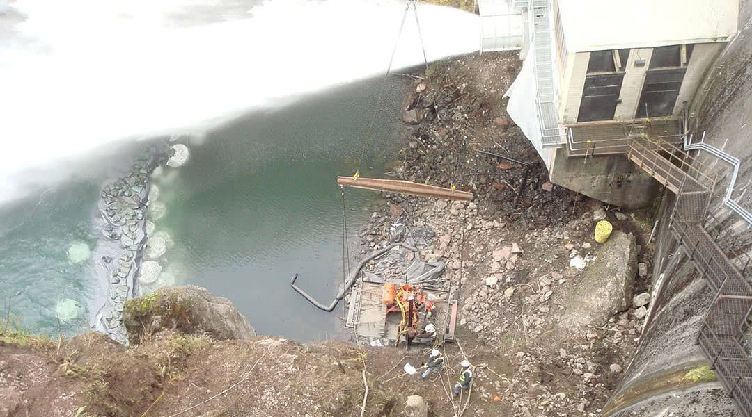 McCallum Rock Team Working Near Base of Water at Lake Cushman Dam